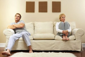 photolibrary_rf_arguing_couple_on_sofa